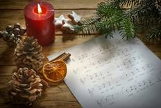music sheet and candle