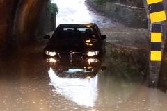 Car in flood Milkingpen Lane -Tony Tuck
